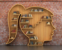 Concept of training. Wooden bookshelf full of books in form of woman head on a bricks background. Science about human. Psychology. A human have more knowledge royalty free stock photo