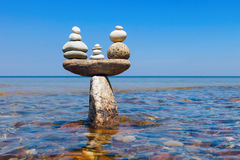 Concept of tranquility and balance. Rock zen in the form of scales. Stock Image