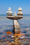 Concept of tranquility and balance. Rock zen in the form of scales. Stock Photo