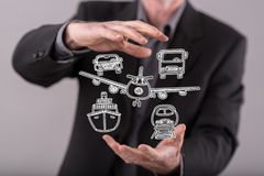 Concept of transportation. Transportation concept between hands of a man in background Royalty Free Stock Photography
