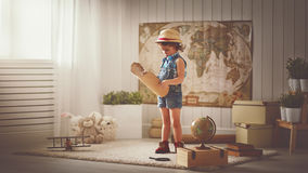Concept travel. child girl at home dreaming of travel and touris. M, exploring the world map and globe Stock Photo
