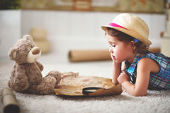 Concept travel. child girl at home dreaming of travel and touris Royalty Free Stock Images