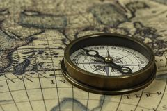 Retro compass with old map. Concept of travel and discovery with old map and compass on it Royalty Free Stock Photos