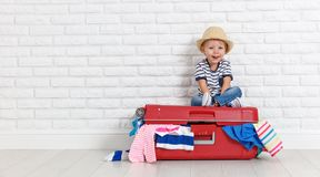 Concept travel. happy funny boy child with suitcase. Concept travel. a happy funny boy child with suitcase royalty free stock image