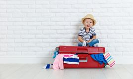 Concept travel. happy funny boy child with suitcase. Concept travel. a happy funny boy child with suitcase Royalty Free Stock Photos