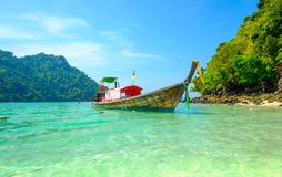 Concept of travel and relax. Beautiful local fishing boats on se Royalty Free Stock Photos