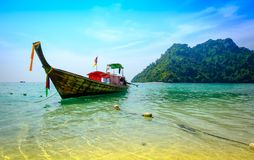 Concept of travel and relax. Beautiful local fishing boats on se Stock Image