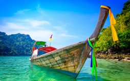 Concept of travel and relax. Beautiful local fishing boats on se Stock Photos