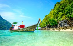 Concept of travel and relax. Beautiful local fishing boats on se Royalty Free Stock Photo