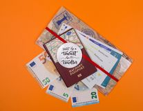 Concept - travel to Europe. Close-up on a orange background holiday vacation boarding pass tourist business money tourism tickets passport journey traveller stock image