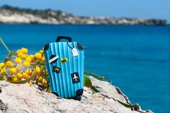 Concept travel to the sea. Stylish suitcase against the blue sea. Space for the test royalty free stock image