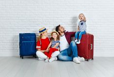 Concept travel and tourism. happy family with suitcases. Near empty wall Stock Images