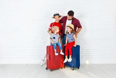 Concept travel and tourism. happy family with suitcases near   w Royalty Free Stock Images