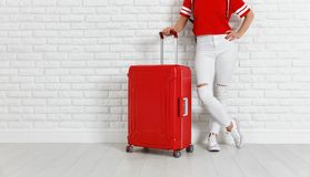 Concept travel and tourism. legs of girl with a red suitcase ne royalty free stock photos