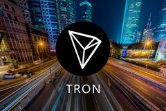 Concept of TRON Coin or TRX, a Cryptocurrency blockchain platform , Digital money, Cityscape. Background royalty free stock photography