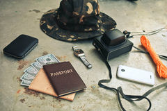 Concept turism.Items include an old photo camera, passport, wall Stock Photography