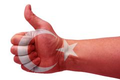 The concept of Turkey-the hand gives a thumbs up with the flag of Turkey. The hand and the flag of Turkey royalty free stock images