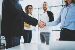 Concept two coworkers handshaking process.Business partnership handshake.Blurred background.Cropped. Concept two coworkers handshaking process.Business Royalty Free Stock Photo