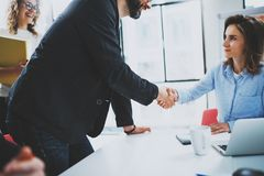 Concept two coworkers handshaking process.Business partnership handshake.Successful deal after great meeting.Blurred. Background Stock Photos
