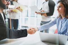 Concept two coworkers handshaking process.Business partnership handshake.Successful deal after great meeting at sunny. Meeting room Royalty Free Stock Photos