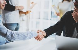 Concept two coworkers handshaking process.Business partnership handshake.Successful deal after great meeting at sunny. Meeting room.Cropped royalty free stock photography
