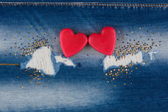 The concept of two lovers hearts lying on the jeans Stock Photos