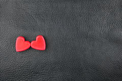 The concept of two lovers hearts lying on the natural leather Royalty Free Stock Photos