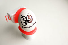Concept of unprofitable business. An egg with royalty free stock images