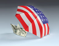 Concept of usa and dollar currency. One umbrella with the usa flag and a paper boat made with dollar banknotes, concept of safety (3d render Royalty Free Stock Photo