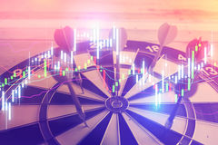Concept using dart in the bullseye on dartboard Stock Image