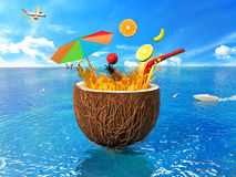The concept of vacation. Coconut, beach umbrella and fruit juice Stock Photo