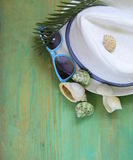 Concept vacation, shells, sunglasses and a hat Royalty Free Stock Images