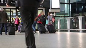 Concept vacations people walking modern airport terminal July 2017 London UK stock footage