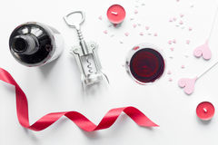 Concept Valentine Day with wine at white background top view. Concept of Valentine Day with wine at white background top view Stock Photography
