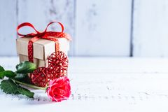 Concept photography of Valentine`s gift. Concept of Valentine`s day gift on wooden table royalty free stock image