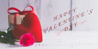 Concept photography of Valentine`s gift. Concept of Valentine`s day gift on wooden table royalty free stock photography