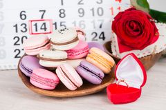 Concept Valentine`s Day, gold ring, heart and pastries on backgr. Ound on the calendar for February 14 Stock Images