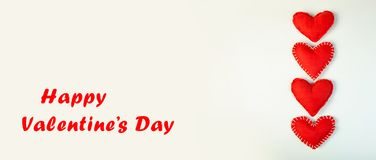 Concept Valentine`s Day. Small Soft Pads Hearts on Light Background. Banner Stock Photo