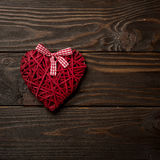 Concept of Valentine`s Day. Wicker hearts on dark wooden backgro royalty free stock image
