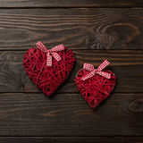 Concept of Valentine`s Day. Wicker hearts on dark wooden backgro royalty free stock photos