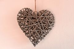 Concept Of Valentine`s Day. Wicker hearts on pink background royalty free stock image