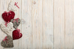 Concept Of Valentine's Day. Wicker hearts on wooden background w Stock Images