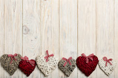 Concept Of Valentine's Day. Wicker hearts on wooden background w Royalty Free Stock Photography
