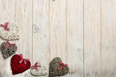 Concept Of Valentine's Day. Wicker hearts on wooden background w Royalty Free Stock Photos
