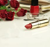 Concept for Valentine`s Day, Women day, Mother`s day.feminine desk, workspace . Concept for Valentine`s Day, Women day, Mother`s day. Red lipstick, nail polish Royalty Free Stock Image