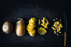 Concept of various stages of cutting raw potatoes top view Royalty Free Stock Photography