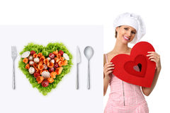 Concept vegetarian diet chef woman pointing billboard salad heart shape Stock Image