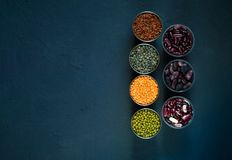 Concept of vegetarian food. Cereals and legumes on a blue concrete background. Top view, stock images