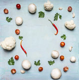 Concept of vegetarian food frame cauliflower tomato paste and red pepper parsley mushrooms rustic wooden background top view sp Royalty Free Stock Images