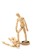 Concept of victor and beaten: one wooden mannequin / doll standing over another Stock Image